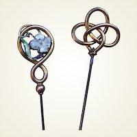 Two Art Nouveau hat pins enamel and interlaced decoration