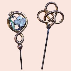 Two Art Nouveau hat pins enamel and interlaced decoration