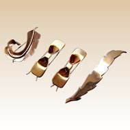 A collection of hair barrettes or clips Mid Century gold tone metal hair accessory