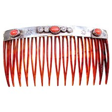 A handsome Native American silver and coral embellished hair comb