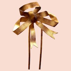 Bow design hair comb late Victorian gilded hair accessory