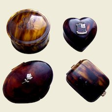 Four faux tortoiseshell vanity items powder compact pill box