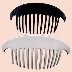 Two modernist style hair combs signed by Pierre Olivier