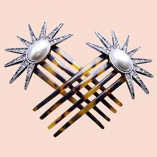 A pretty matched pair of star design hair accessories from the mid century