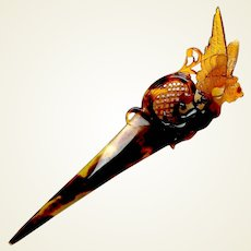 Single pronged hair comb with figural angel hair accessory