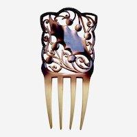 Art Nouveau celluloid hair comb with holly leaf design