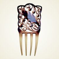 Art Nouveau celluloid hair comb with holly leaf design