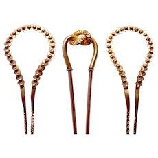 Three late Victorian hair pins or hair comb accessories