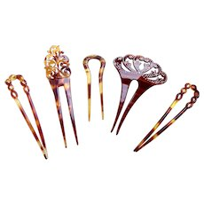 Five early 20th century hair pins faux tortoiseshell hair ornaments