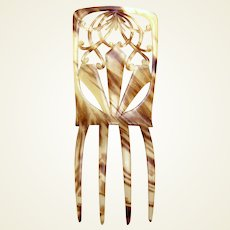 A Spanish style faux tortoiseshell hair comb from the late Victorian period