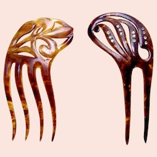 Two Edwardian faux tortoiseshell hair combs with asymmetric styling