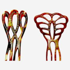 Two rhinestone hair combs from the mid century hair ornament