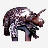 Novelty retro 1980s hair comb with dinosaur triceratops hair ornament