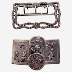 Two vintage belt buckles Art Moderne and oriental characters
