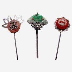 Three Oriental carnelian or jadeite hair pins or headdress ornaments (AAT)