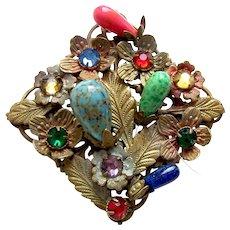 A pretty mid century brooch in Hollywood Regency multi colour rhinestones
