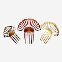 Three celluloid Art Deco hair combs classic sunray designs
