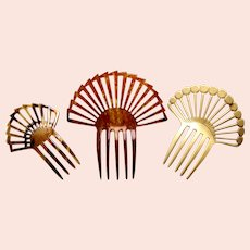 Three celluloid Art Deco hair combs classic sunray designs