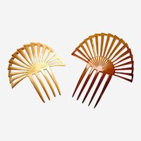 Two celluloid Art Deco hair combs classic sunray designs