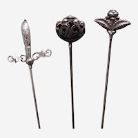 Edwardian hatpins with fancy metal topped hat ornaments