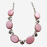 Coro pink thermoset Lucite moon glow necklace mid century