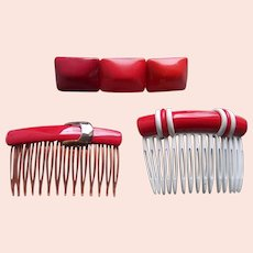 Three red themed 1980s hair accessories combs barrette