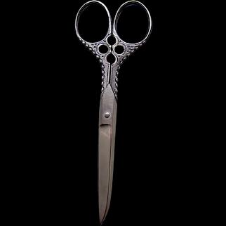 Pair of ornate vintage steel sewing scissors