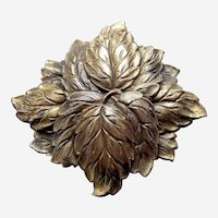 Art Nouveau brooch moulded brass leaf shape