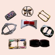 Eight Art Deco belt buckles or clasps in various materials