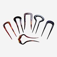Six practical celluloid hair pins or two pronged hair combs