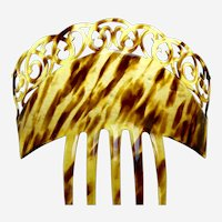 A large and handsome celluloid faux tortoiseshell hair comb from the mid century