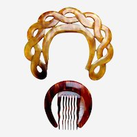 Two crescent shaped hair combs or hair accessories