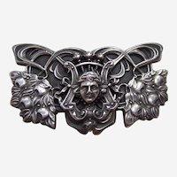 Art Nouveau belt or dress buckle with figural female face