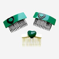 Three vintage hearts themed hair combs 1980s