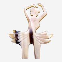 Steer horn hair comb with figural ballerina hair accessory