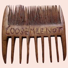 Carved wooden folk vanity comb with inscription