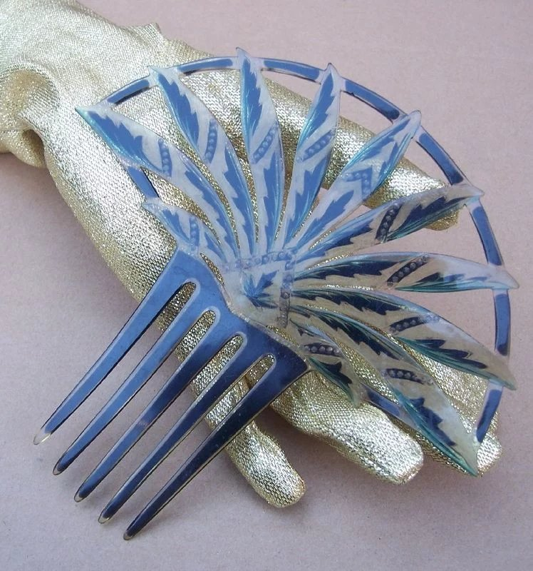 egyptian revival hair comb with blue rhinestone trim the