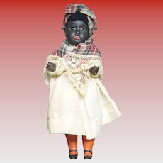 "Black Paper Mache' 5 1/2"" Doll marked 34"