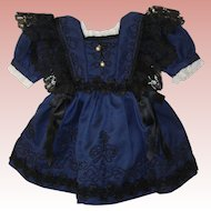 Antique Doll Dress with antique laces and trims.