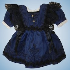 Antique Doll Dress with antique laces and trims .