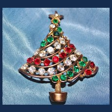 Vintage, Unsigned, Gold Toned Christmas Tree with Green, Clear,  and Red Rhinestones