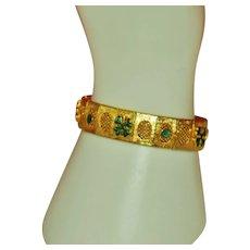 Vintage Unsigned Gold Toned Bracelet with Green 4 Leaf Shamrocks