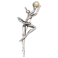 Vintage Unsigned Silver Toned Ballerina Brooch Holding an Orb