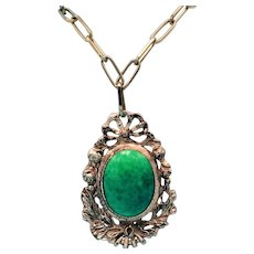Vintage Etruscan Revival Gold Toned Medallion Necklace with a Large Marble Green Cabochon