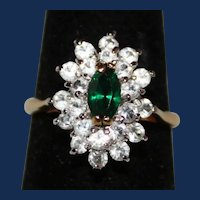Vintage Gold Tone Ring - Signed K with 1 Green and Several Clear Rhinestones