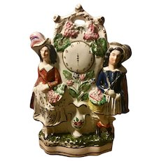 Large Mid 19th century English Staffordshire Pottery two Females with Baskets, Vines of Grapes, Flowers and  Leaves around a Clock Dial