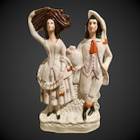 19th Century English Staffordshire male-female group figures with jug and wheat, flat back