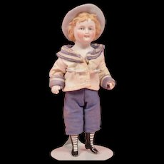 Rare Early All Bisque Boy with Molded Hat - 7 Inches