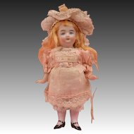 Adorable German All Bisque Child with Shirred Pink Stockings - 4.75 Inches