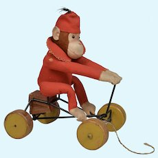 "Charming Early Steiff Dressed ""Record"" Monkey Wheeled Toy - 9 inches tall."